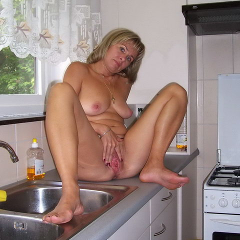 Nude housewife pics in the kitchen