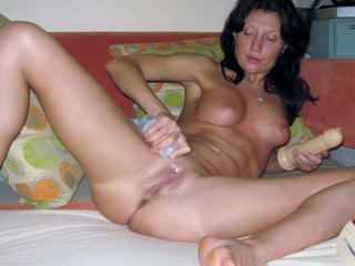 Hot woman fucking with dildo on the sofa 1
