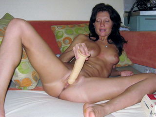 Hot woman fucking with dildo on the sofa 18