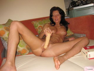 Hot woman fucking with dildo on the sofa 14
