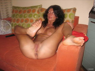 Hot woman fucking with dildo on the sofa 15