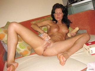 Hot woman fucking with dildo on the sofa 13
