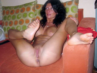 Hot woman fucking with dildo on the sofa 17